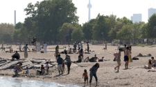Toronto residents flock to the beach as record high temperatures hit the region Wednesday, May 26, 2010. (Frank Gunn / THE CANADIAN PRESS)