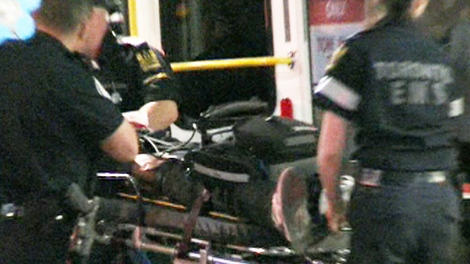 Paramedics rush a man to hospital after he was shot in North York on May 25, 2010.