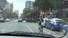 A biker travels in a designated lane on Burrard Street. May 27, 2010. (CTV)