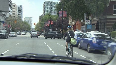 A biker travels in a designated lane on Burrard Street. May 27, 2010. (CTV)