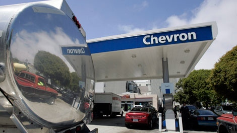 File image. The reflection from a gas tanker truck is shown at a Chevron gas station in San Francisco. (AP Photo/Paul Sakuma, File)