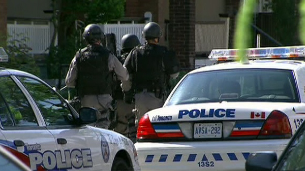Emergency Task Force officers for the shooting suspect after an apparent dispute between neighbours in west-end Toronto on Thursday, May 27, 2010.