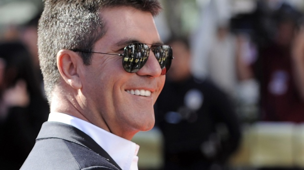 Simon Cowell arrives at the 'American Idol' finale on Wednesday, May 26, 2010, in Los Angeles. (AP / Chris Pizzello)