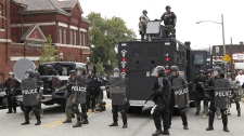 A Long-Range Acoustic Device is seen mounted atop a law enforcement vehicle on the streets of Pittsburgh during the G-20 Summit, Thursday Sept. 24, 2009. (AP / Matt Rourke)
