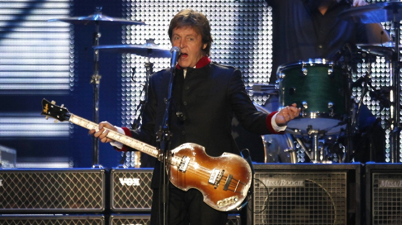 """Britain's musician Paul McCartney performs during his """"Up and Coming"""" tour at the Foro Sol in Mexico City, Thursday, May 27, 2010. (AP Photo/Eduardo Verdugo)"""