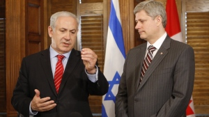 Israeli Prime Minister Benjamin Netanyahu makes brief comments following his meeting with Prime Minister Stephen Harper following their meeting on Parliament Hill Monday May 31, 2010. (Adrian Wyld  / THE CANADIAN PRESS)