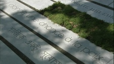"""Slabs bearing the inscription """"give peace a chance"""" lie side-by-side on Mount Royal (May 31, 2010)"""