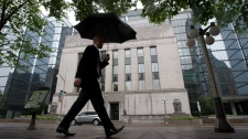 A pedestrian walks past the Bank of Canada in Ottawa, Canada Tuesday June 1, 2010. (Adrian Wyld / THE CANADIAN PRESS)