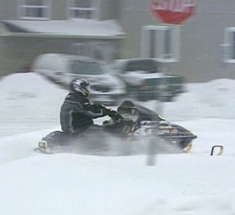 One resident opts to use his snowmobile instead of a car on the snowy Barrie streets on Monday, Dec. 3, 2007.