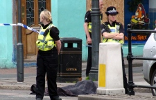 Police stand next to a body following a shooting on Duke Street, in the town of Whitehaven in northwest England Wednesday June 2, 2010. (AP / Rod Minchin)