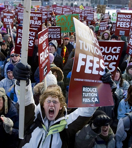 Mathew Hawland of Ottawa University joins hundreds of other students protesting high tuition fees on Parliament Hill, in Ottawa Wednesday Feb 7, 2007. (CP PHOTO/Tom Hanson)