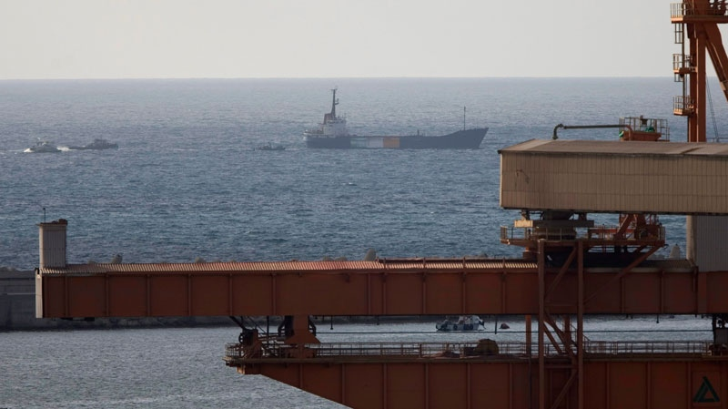 Israeli naval ships, left, escort the 1,200-ton Gaza-bound ship Rachel Corrie into the port of Ashdod, Israel, Saturday, June 5, 2010.  (AP / Ariel Schalit)