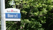 """A man takes a photo of a new """"Route of Heroes"""" street sign in Toronto, Monday, June 7, 2010.  (Colin Perkel / THE CANADIAN PRESS)"""