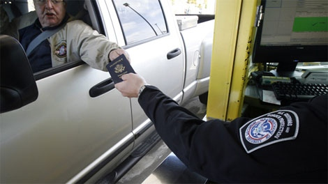 A driver hands his passport to a border agent at the Canada / U.S. border crossing in Highgate Springs, Vt., Monday, June 1, 2009. (AP / Toby Talbot)