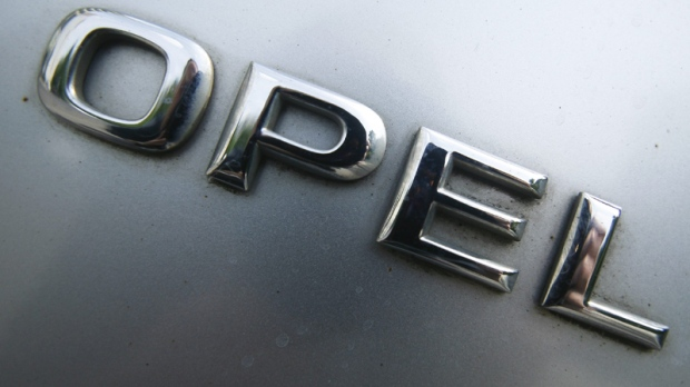 The letters of General Motors Co.'s Opel unit photographed on a car in Berlin, on Wednesday, June 9, 2010. (AP Photo/Markus Schreiber)