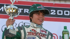 Go-kart racer Lance Stroll celebrates on a podium in this 2009 handout photo. The Ferrari Driver Academy has signed 11-year-old Montrealer Lance Stroll, making him the youngest driver to enter the program in Maranello, Italy. (THE CANADIAN PRESS/HO, Jim Leggett/CanadianKartingNews.com)