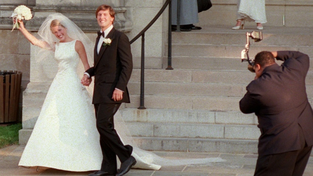 Photographer Calvin Hayes closes in on newly-weds Karenna Gore and Andrew Schiff outside Washington's National Cathedral after their wedding ceremony on  Saturday July 12, 1997.  (AP  /Karin Cooper)