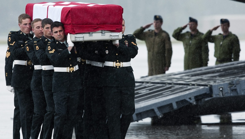 Military pallbearers carry the casket of Sgt. Martin Rene Goudreault during a repatriation ceremony at CFB Trenton on Wednesday, June 9, 2010 in Trenton, Ont. (Nathan Denette / THE CANADIAN PRESS)