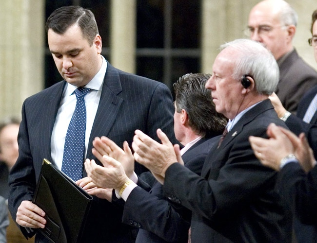 Conservative MP James Moore receives applause from caucus, acknowledging their support for Moore, in the House of Commons on Parliament Hill in Ottawa, Thursday, Dec. 6, 2007. (Tom Hanson / THE CANADIAN PRESS)