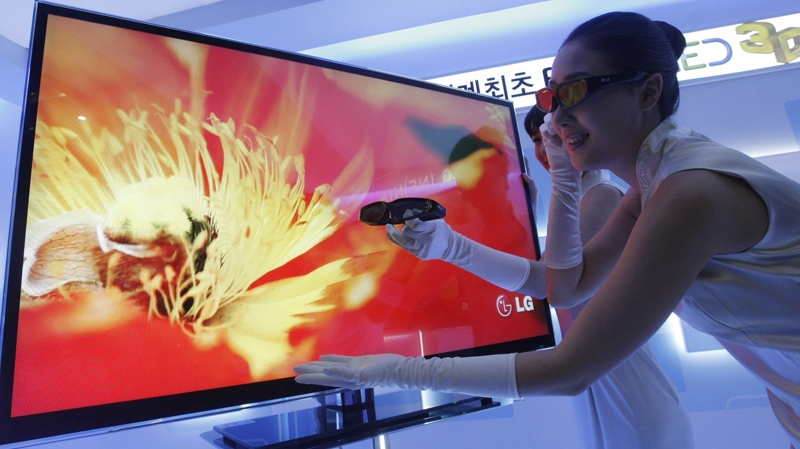 a model wears special glasses to view the worlds first full led 3d tv by lg