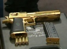 A gun seized during the raids is put on display at police headquarters in downtown Toronto on Friday, Dec. 7, 2007.