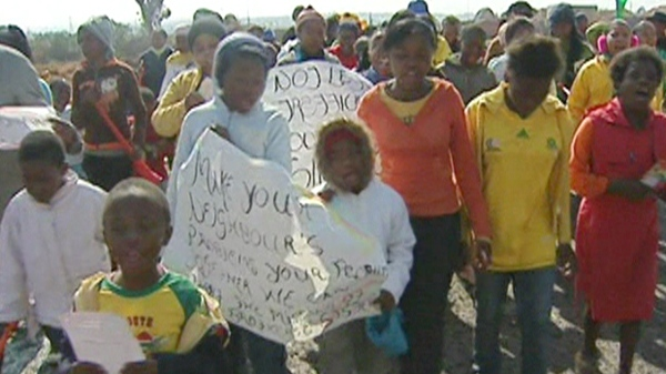 A group of orphans in the care of the Salvation Army rally against human trafficking in Soweto, South Africa.