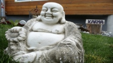 This big, concrete garden Buddha was stolen from a woman's front yard in Surrey, April 2010. (ItsLongGone.com)