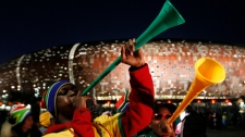 Fans blow vuvuzelas following the World Cup group A soccer match between South Africa and Mexico at Soccer City in Johannesburg, South Africa, Friday, June 11, 2010. The game ended in a 1-1 draw. (AP Photo/Hassan Ammar)
