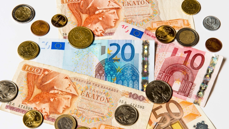 A collection of old Greek Drachma and Euro notes and coins, pictured in Brussels, Tuesday May. 22, 2012. (AP Photo/Geert Vanden Wijngaert)