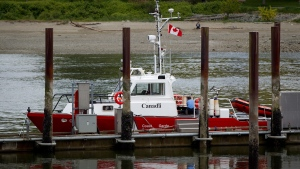 A member of the Coast Guard works on a vessel moored at the Coast Guard's Kitsilano Station in Vancouver, B.C., on Friday May 18, 2012.  (Darryl Dyck / THE CANADIAN PRESS)