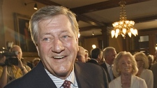 Former Ontario Premier Mike Harris smiles at the unveiling ceremony for his official portrait at the Ontario Legislature in Toronto on Tuesday, June 26, 2007. (CP PHOTO/Frank Gunn)