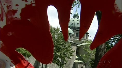 Three women's groups stage a protest against Prime Minister Stephen Harper's stance on abortion.