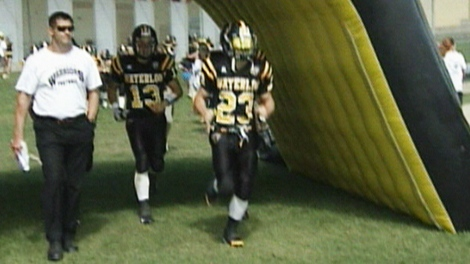 Members of the University of Waterloo football team, including Warriors receiver Nathan Zettler in the number 23 jersey, are seen in this undated photo.