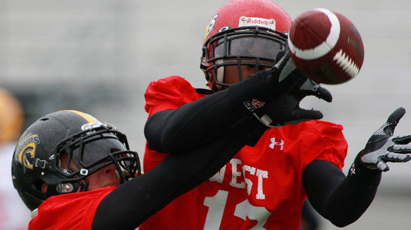 A York University player catches the ball as a University of Waterloo player defends during practice for the Canadian Interuniversity Sport East West Football Game at TD Waterhouse stadium in London, Ontario, Friday, May 7, 2010. (Dave Chidley / THE CANADIAN PRESS)
