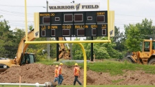 Construction crews tear up the University of Waterloo Warriors football field in Waterloo, Ontario, Monday, June 14, 2010. (Dave Chidley / THE CANADIAN PRESS)