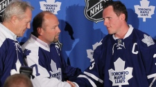 Newly-announced Toronto Maple Leafs captain Dion Phaneuf is congratulated by former Maple Leafs captains Darryl Sittler and Wendel Clark during a press conference in Toronto, Monday, June 14, 2010. (Darren Calabrese / THE CANADIAN PRESS)