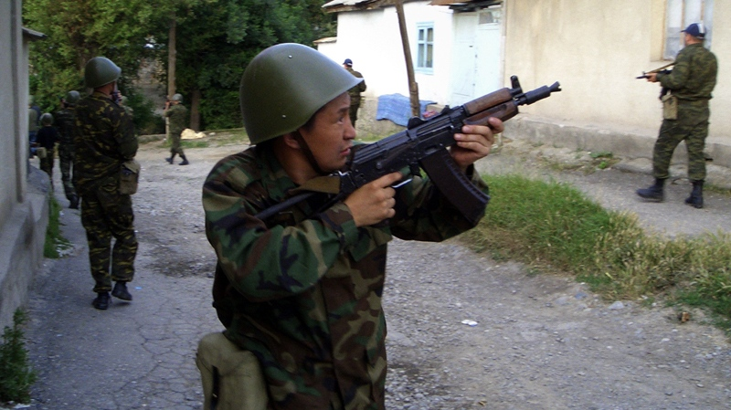 Kyrgyz Interior Ministry forces conduct house-to-house searches in the Anoshin neighborhood in the city of Osh, southern Kyrgyzstan, Monday, June 14, 2010. (AP / Alexander Merkushev)
