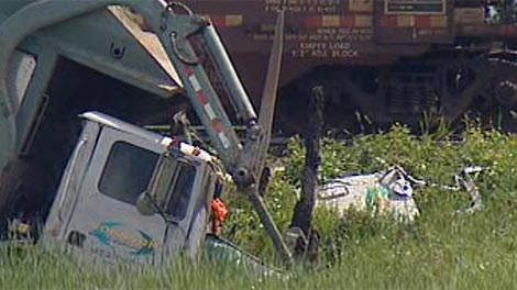 RCMP believe the driver was thrown from the truck before the crash with the train.