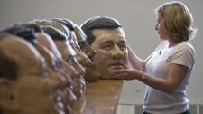 Oxfam 39 s giant heads of world leaders arrive for g8 ctv news for Adrien harper watches