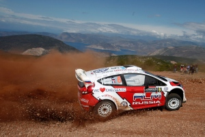 Evgeny Novikov of Russia and co-driver Denis Giraudet of France, in their Ford Fiesta RS WRC compete at the WRC Acropolis Rally at the stage of Elikonas, central Greece, on Friday, May 25, 2012. (AP Photo/Petros Giannakouris)