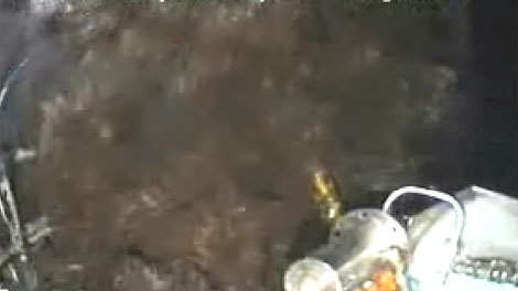 This image from video provided by BP PLC shows oil continuing to pour out at the site of the Deepwater Horizon oil well in the Gulf of Mexico, Tuesday afternoon, June 14, 2010.