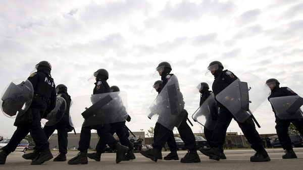 A Public Safety Unit walks as the Toronto police demonstrate the security mesures in view of the G8 and G20 summit in Toronto on Thursday, June 3, 2010. (Adrien Veczan / THE CANADIAN PRESS)