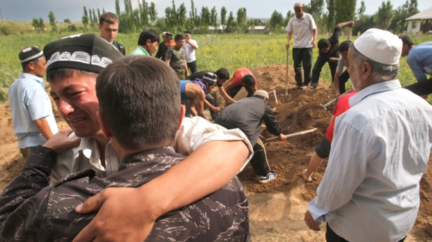 Uzbek men mourn during funeral ceremony of a victim who died after ethnic rioting between Kyrgyz and ethnic Uzbeks, in the southern Kyrgyz city of Osh, Tuesday, June 15, 2010. (AP / Sergei Grits)