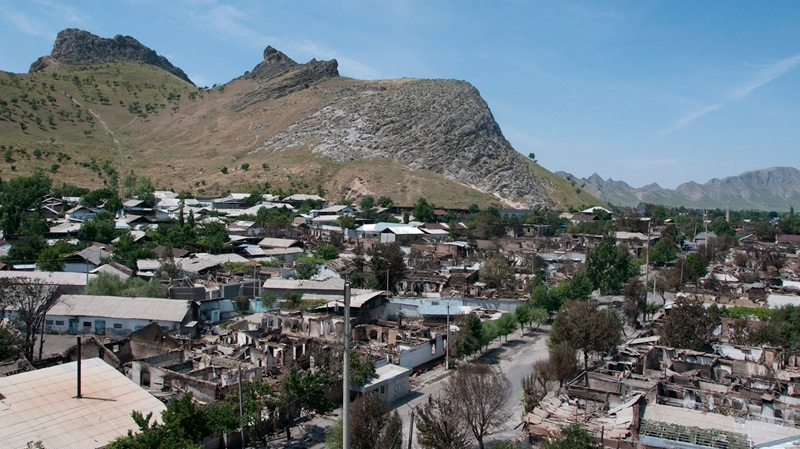 A view of the aftermath in the center of Osh from a minaret in the Uzbek neighborhood of the area, after days of ethnic rioting between Kyrgyz and ethnic Uzbeks, in Kyrgyzstan, Monday, June 14, 2010. (AP / Dalton Bennett)