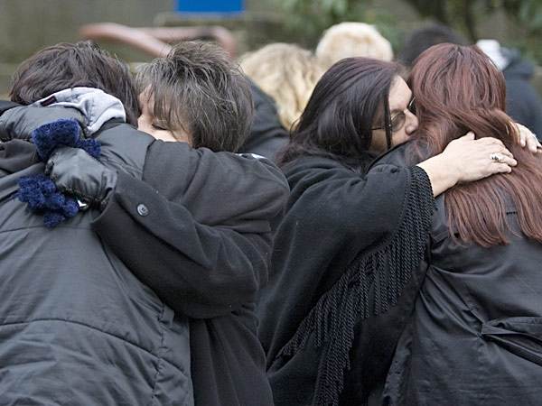Family members of some of the victims of murderer Robert Pickton hug outside the B.C. Supreme Court in New Westminster, B.C. Tuesday, December 11, 2007. (Jonathan Hayward / THE CANADIAN PRESS)