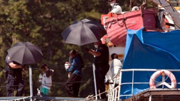 Migrants escorted off MV Sun Sea in Colwood, B.C.
