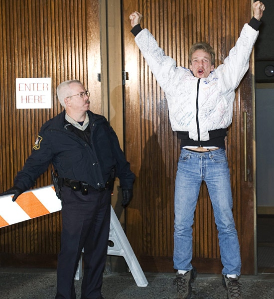 A friend of victims' families, Murray Watson, jumps for joy as he leaves the B.C. Supreme Court in New Westminster, B.C. Tuesday, December 11, 2007. (Jonathan Hayward / THE CANADIAN PRESS)