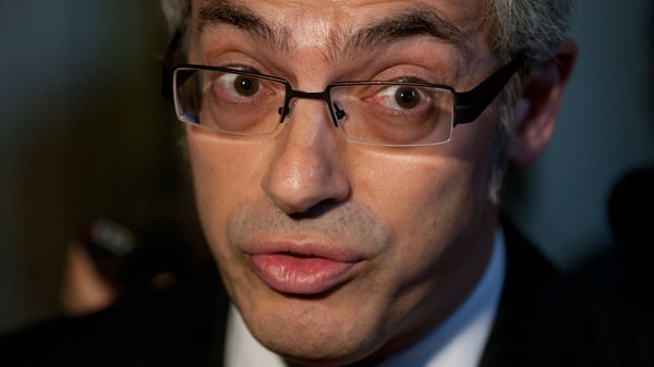 Minister of Industry Tony Clement comments on projects in his riding as he speaks with the media following party caucus meetings on Parliament Hill in Ottawa, Wednesday June 16, 2010. (Adrian Wyld / THE CANADIAN PRESS)