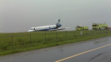 A United Express plane is seen after skidding off the runway at Ottawa's airport on Wednesday, June 16, 2010. (Heinz Bloess for CTV News)