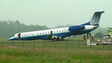 A United Express plane is seen after it slid off the runway at Ottawa's Macdonald-Cartier International Airport Wednesday afternoon, June 16, 2010.